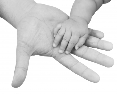 Father and baby hand
