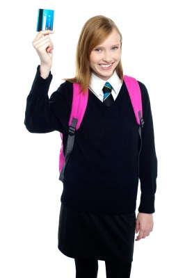 Teenage student holding credit card
