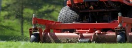 riding lawnmower cutting grass