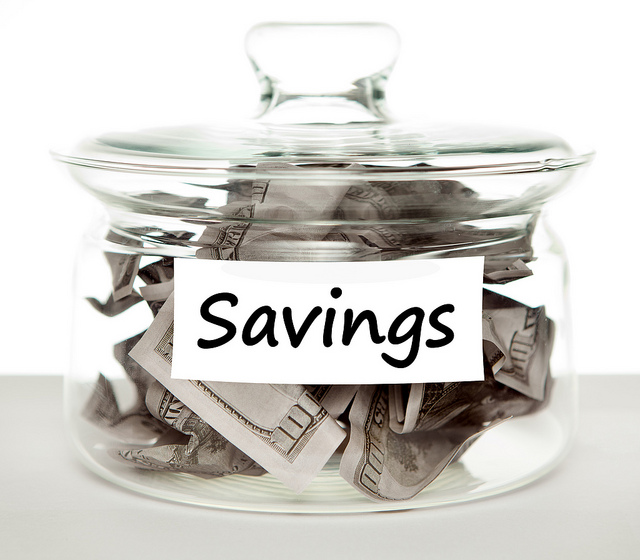 savings jar with $100 bills